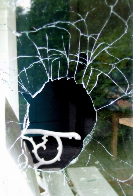 Broken_window_in_a_vandalised_cottage_-_geograph.org.uk_-_1353297.jpg